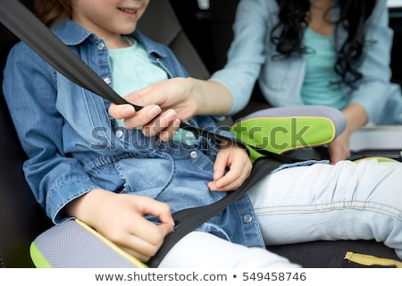 happy woman fastening child with seat belt in car Stock photo © dolgachov