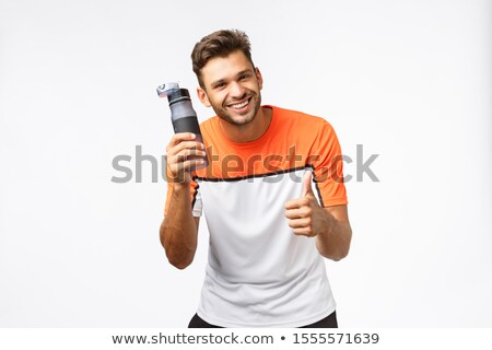 Sportsman recommend drink water workout, encourage lead active, healthy lifestyle. Fitness instructo Stock photo © benzoix