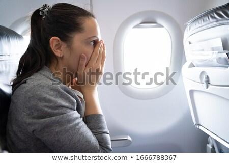 Nő szorongás támadás repülőgép fiatal nő egészség Stock fotó © AndreyPopov
