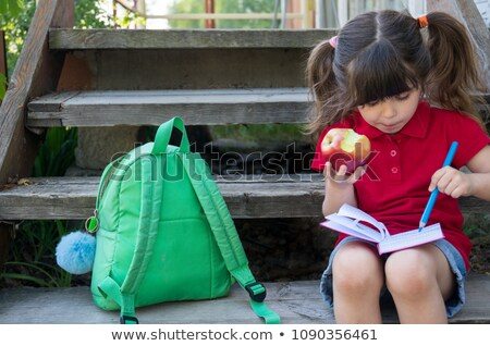 Cute little preschooler girl eating an apple  Stock photo © Lopolo