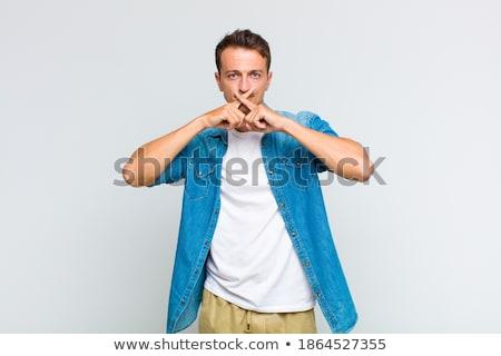 Portré elégedetlen fiatalember gesztikulál csend felirat Stock fotó © deandrobot