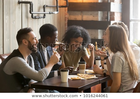 People Drink Coffee Sitting by Table in Cafeteria Stock photo © robuart