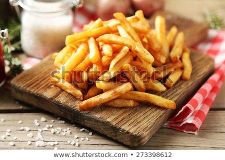 Crisp golden fried french fries Stock photo © olira