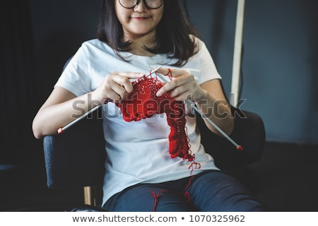 Close up shot of young woman hands knitting a red scarf handicra Stock photo © Freedomz