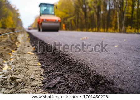asphalt paver machine closeup Stock photo © vlaru