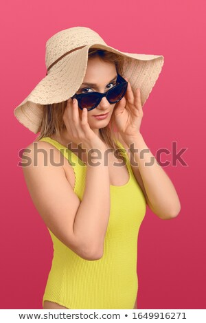 Blonde woman peering over her sunglasses Stock photo © photography33