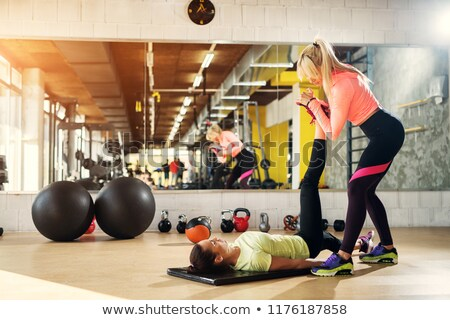 Instructor helping a client stretch Stock photo © photography33