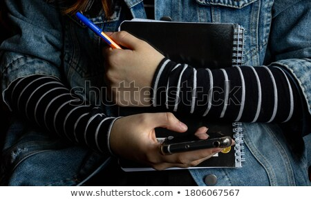Businesswoman clutching diary Stock photo © photography33