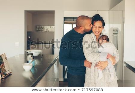 félvér · fiatal · család · újszülött · baba · boldog - stock fotó © feverpitch