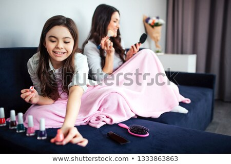 Happy girl putting on some make-up Stock photo © photography33