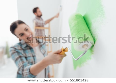 Decorator using roller to paint wall Stock photo © photography33