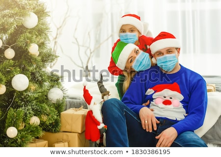 Karácsony portré fiatal lány visel áll karácsonyfa Stock fotó © milsiart