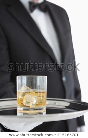 Man holding silver tray with whiskey glass stock photo © wavebreak_media