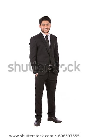 business man with hands in pockets looks at you stock photo © feedough