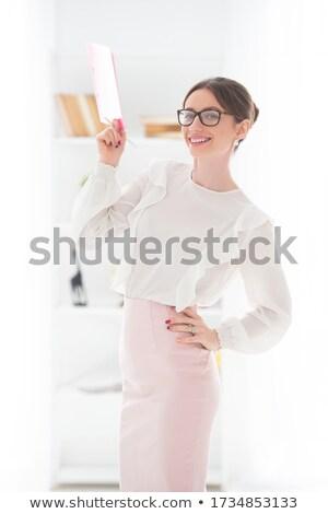 üzletasszony · tanár · pozitív · mappák · szemüveg · néz - stock fotó © lunamarina