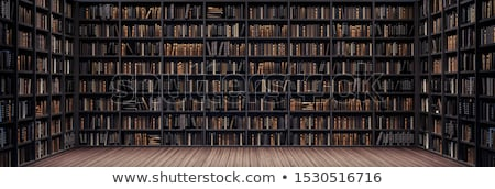 rows of books on bookshelves in library stock photo © zzve