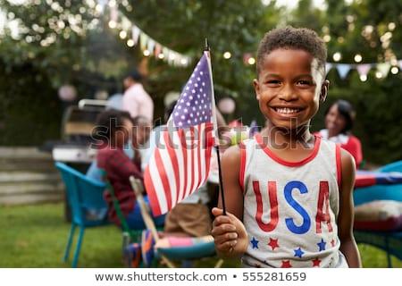Közelkép fiú tart zászló gyermek háttér Stock fotó © zzve