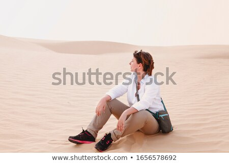 pensive brunette woman sitting on coast stock photo © chesterf