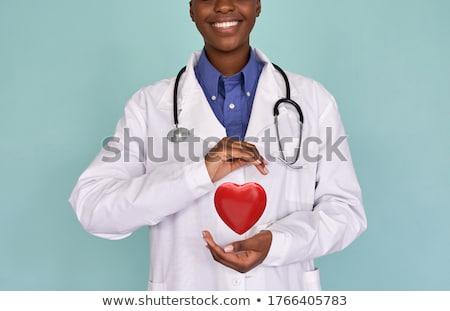 female doctor with heart Stock photo © dolgachov