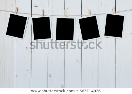 photo paper attach to rope on wooden background  Stock photo © REDPIXEL