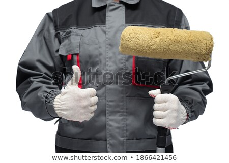 Hand with roller brush and hand showing thumb up. Stock photo © luckyraccoon