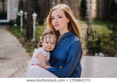 mother and daughter, red haired looking confident and happy Stock photo © meinzahn