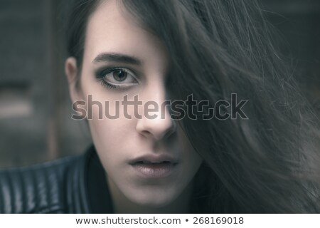 Stock photo: Evocative portrait of a beautiful young woman