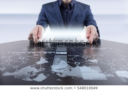 businessman using tablet pc stock photo © stockyimages