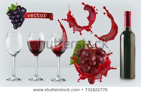 Full red wine glass goblet, bottle and grapes Stock photo © natika