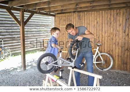 Father And Son Mending Bike Together Stock photo © monkey_business