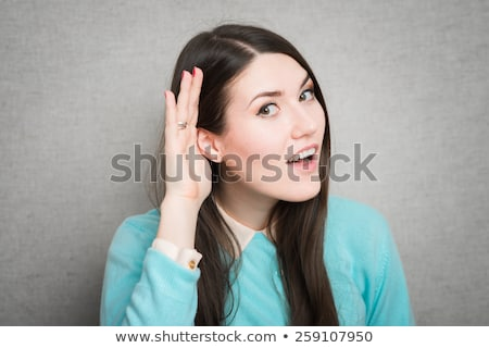 Young Asian woman trying to listen Stock photo © bmonteny
