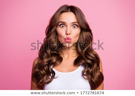 Csinos flörtölő nő kaukázusi szexi narancs Stock fotó © iofoto