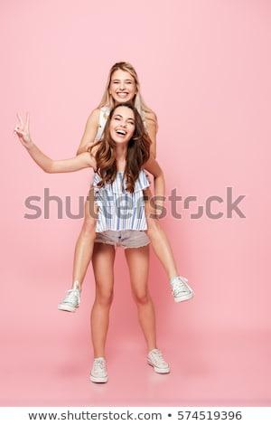 mooie · sexy · jonge · vrouw · grijs · jeans · vrouw - stockfoto © neonshot