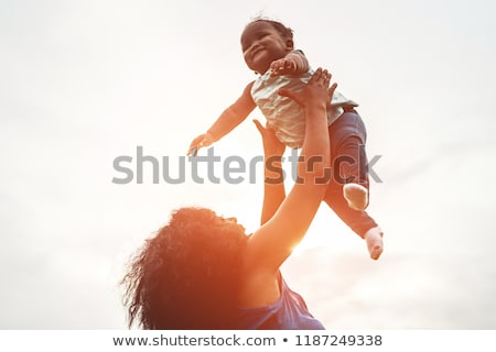 african woman and child at sunset stock photo © adrenalina