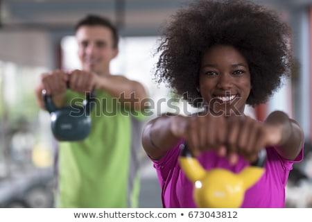 Izmos férfi emel kettlebell crossfit tornaterem Stock fotó © wavebreak_media