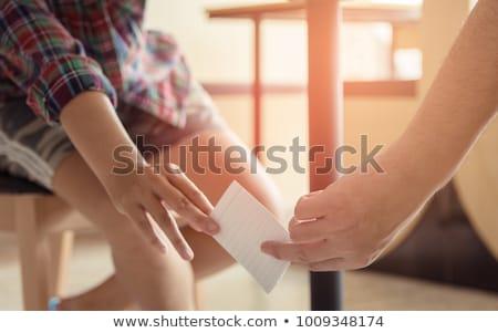 Students passing a cheat-sheet Stock photo © zurijeta