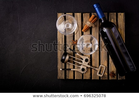 Red wine bottle, glasses, corkscrew, flat lay Stock photo © maxsol7