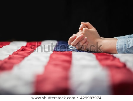 Modląc ręce amerykańską flagę pomoc modlić boga Zdjęcia stock © lincolnrogers