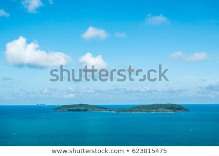 Tengeri kilátás kicsi sziget kristály víz felhők Stock fotó © papa1266