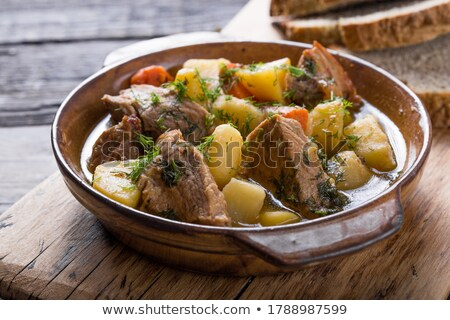 Bread with meat and onions on a wooden table Stock photo © Nobilior