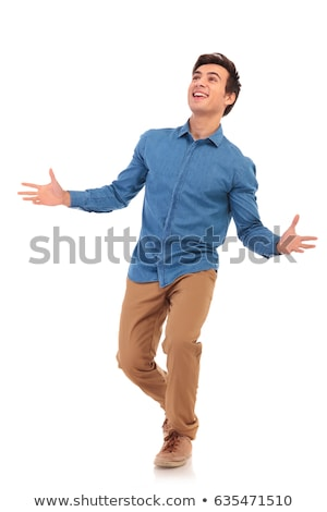 side of an excited casual man inviting and walking Stock photo © feedough