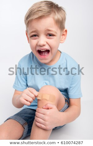 Little boy with patch on knee Stock photo © LightFieldStudios