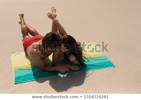 High angle view of couple relaxing on blankets at beach Stock photo © wavebreak_media