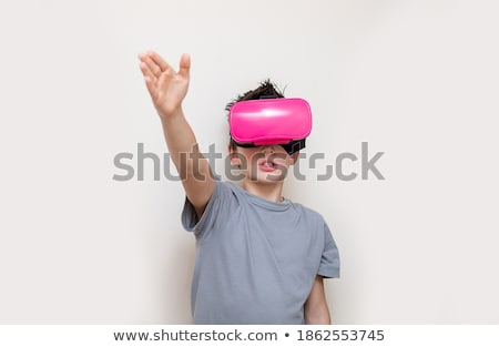 Close up of boy wearing virtual reality simulator gesturing while standing against piano Stock photo © wavebreak_media