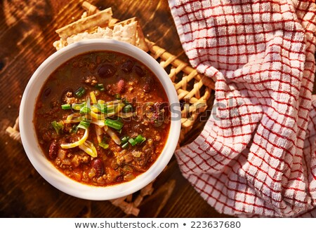 Hearty chili with cheese and scallions Stock photo © klsbear