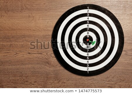 Red Arrow In Dartboard With Goal Text On Wooden Table Stock photo © AndreyPopov