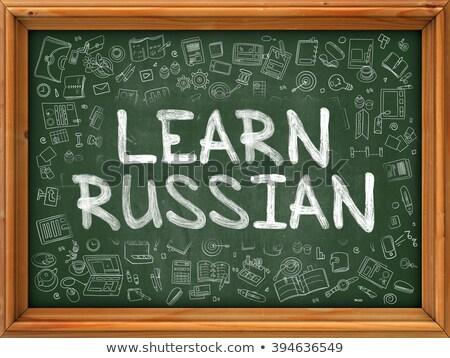 Green Chalkboard with Hand Drawn Learn Russian. Stock photo © tashatuvango