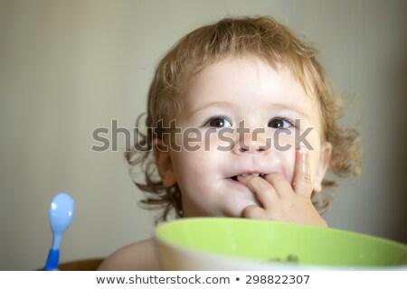 Young boy licking plate Stock photo © IS2