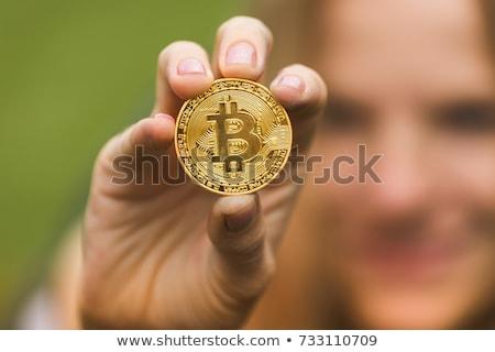 Woman holding Bitcoin BTC cryptocurrency Stock photo © stevanovicigor