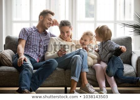sessão · sofá · telefone · móvel · criança - foto stock © monkey_business
